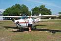 brother jim in front of their rented airplane
